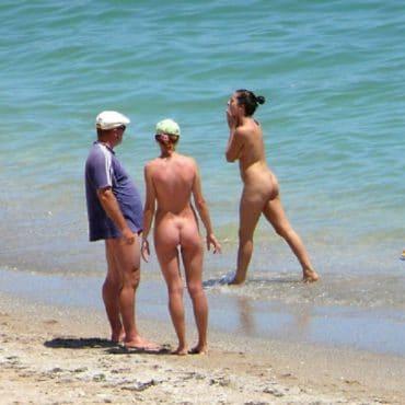 Voyeur am Strand Foto